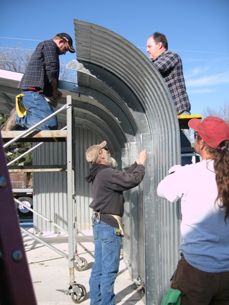 Workers assembled the outer structure of the arch on the new steel building.