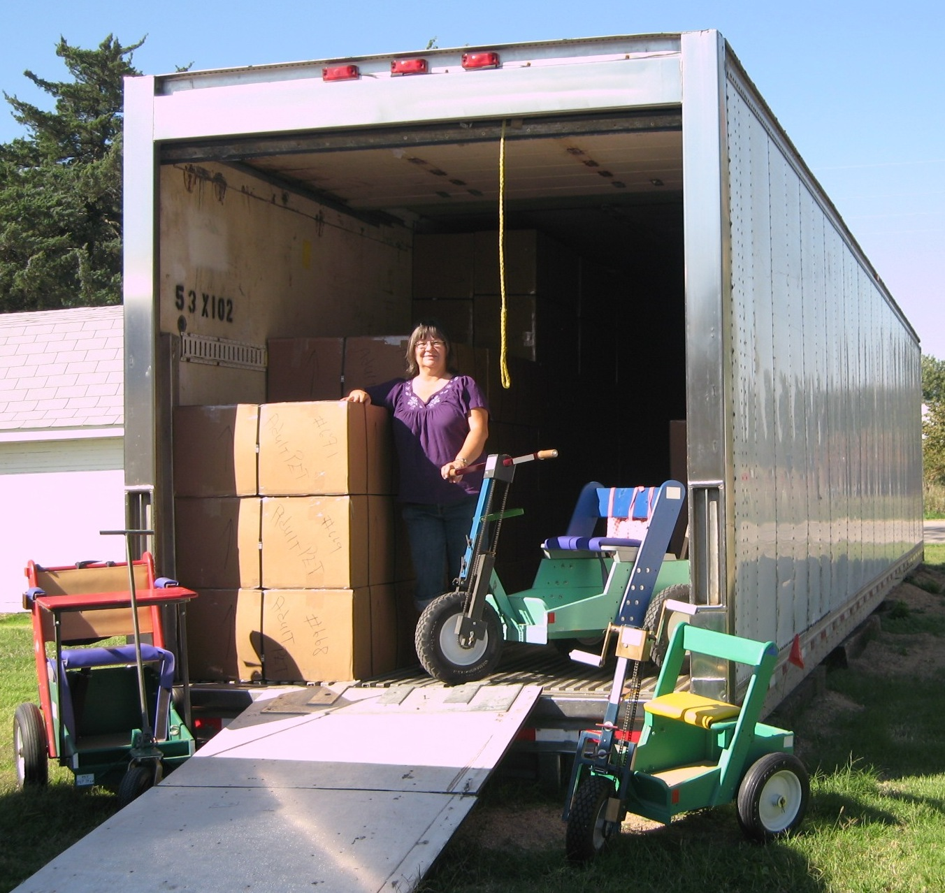 """We also needed a place to store PETs until their shipping date each April. Kirby found a good price on a 53' x 102"""" container. This will save time so we can build more PETs. We already have 121 PETs stored in it for our next mission. When full, the container will hold about 193 PETs, plus sewing machines and Bibles"""